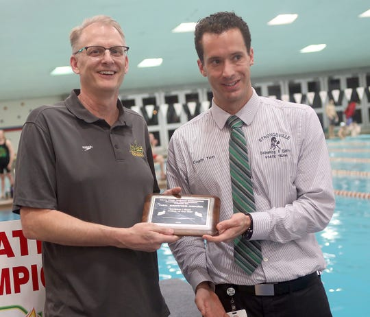 Sycamore head Dan Carl (left) receives the boys coach of the year award at the State Swimming and Diving Championships in Canton Ohio, Saturday, Feb. 23,2019.