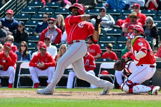 Cincinnati Reds right fielder Phillip Ervin (6) hits a RBI single in the first inning against the Los Angeles Angels at Tempe Diablo Stadium.