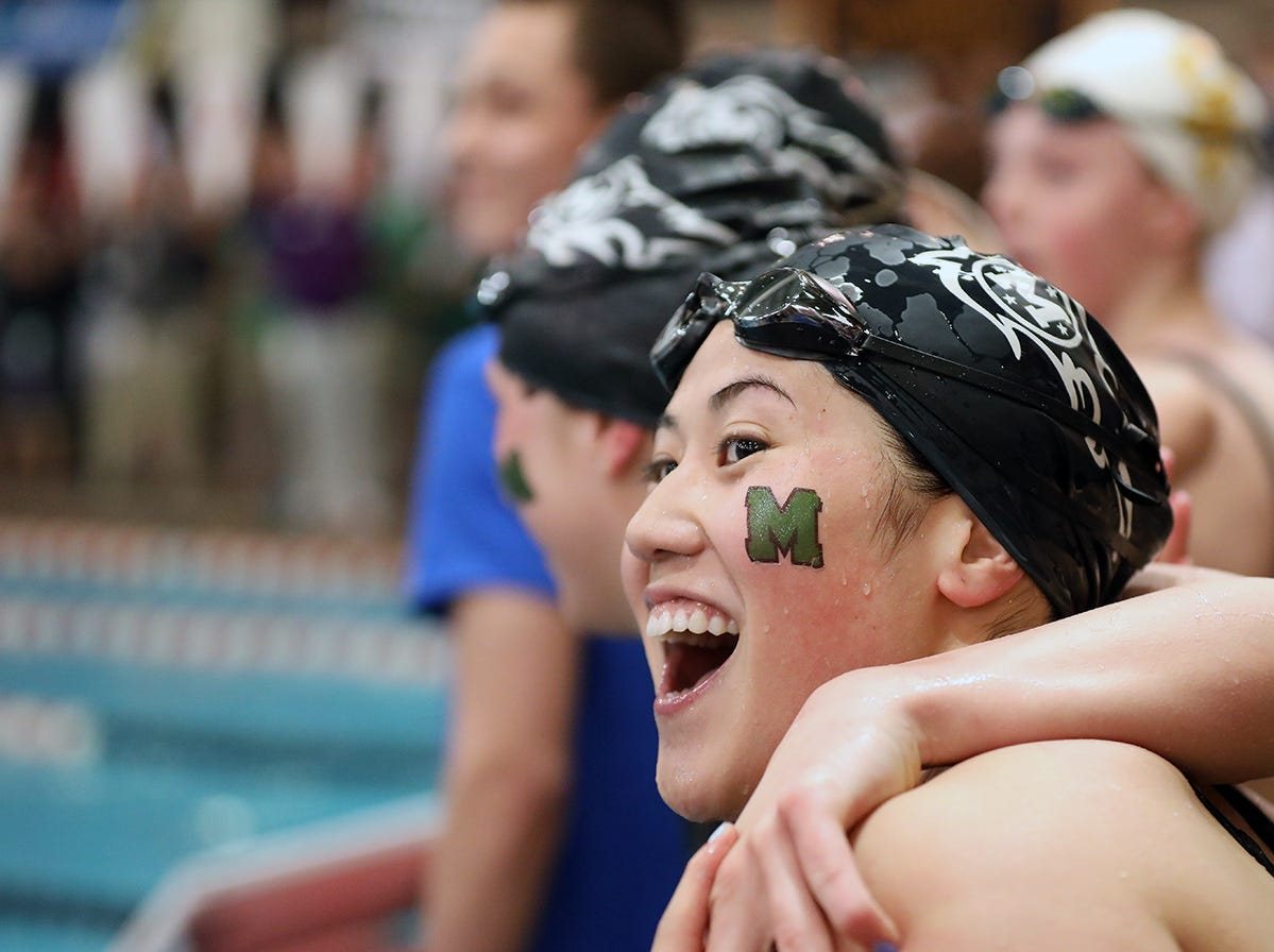 Harna Minezawa and her teammates react at the OHSAA state swimming and diving championships in Canton Ohio, Friday, Feb. 23, 2019.