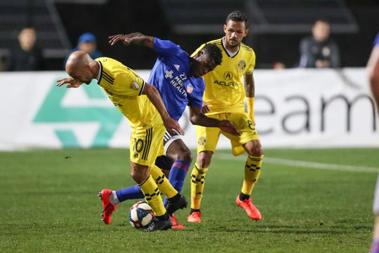 FC Cincinnati midfielder Fatai Alashe (27) and Columbus Crew forward Federico Higuain (10) scramble for the ball during the second half at MUSC Health Stadium. Mandatory Credit: Jim Dedmon-USA TODAY Sports