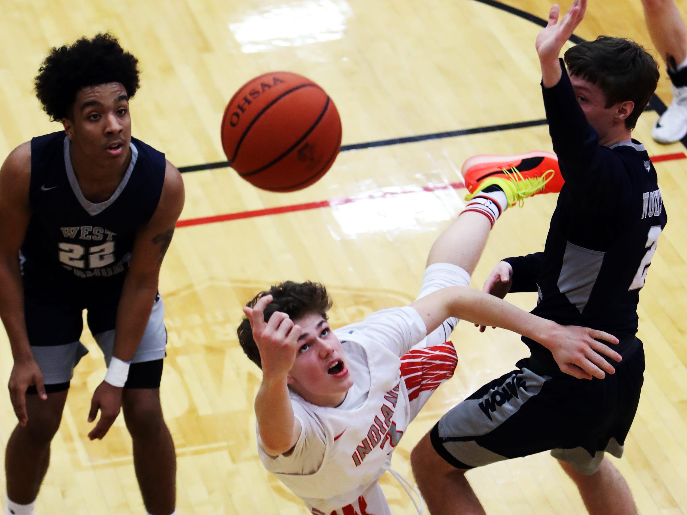 Fairfield guard Logan Murphy attempts a shot through the West Clermont defense.