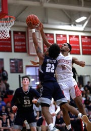 Fairfield guard Devin Turner blocks the shot of West Clermont guard Donte Turner Jr.
