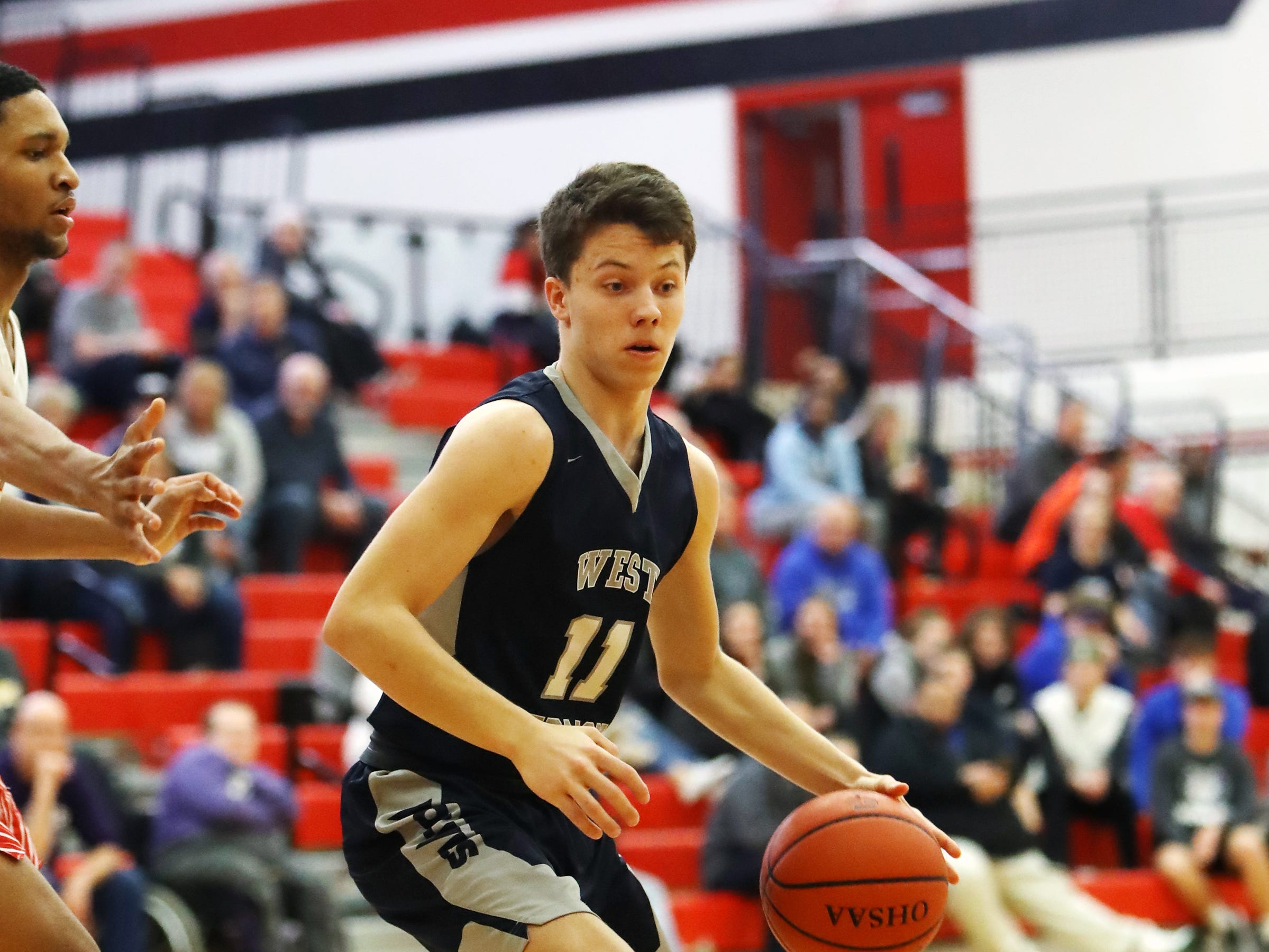 West Clermont guard Hunter Eads looks to get past the Fairfield Indians defense.