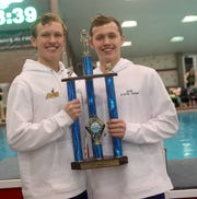 Sycamore swimmers, from left, Jake Foster and Carson Foster share the most outstanding swimmer trophy at the OHSAA state swimming and diving championships in Canton Ohio, Friday, Feb. 23, 2019.