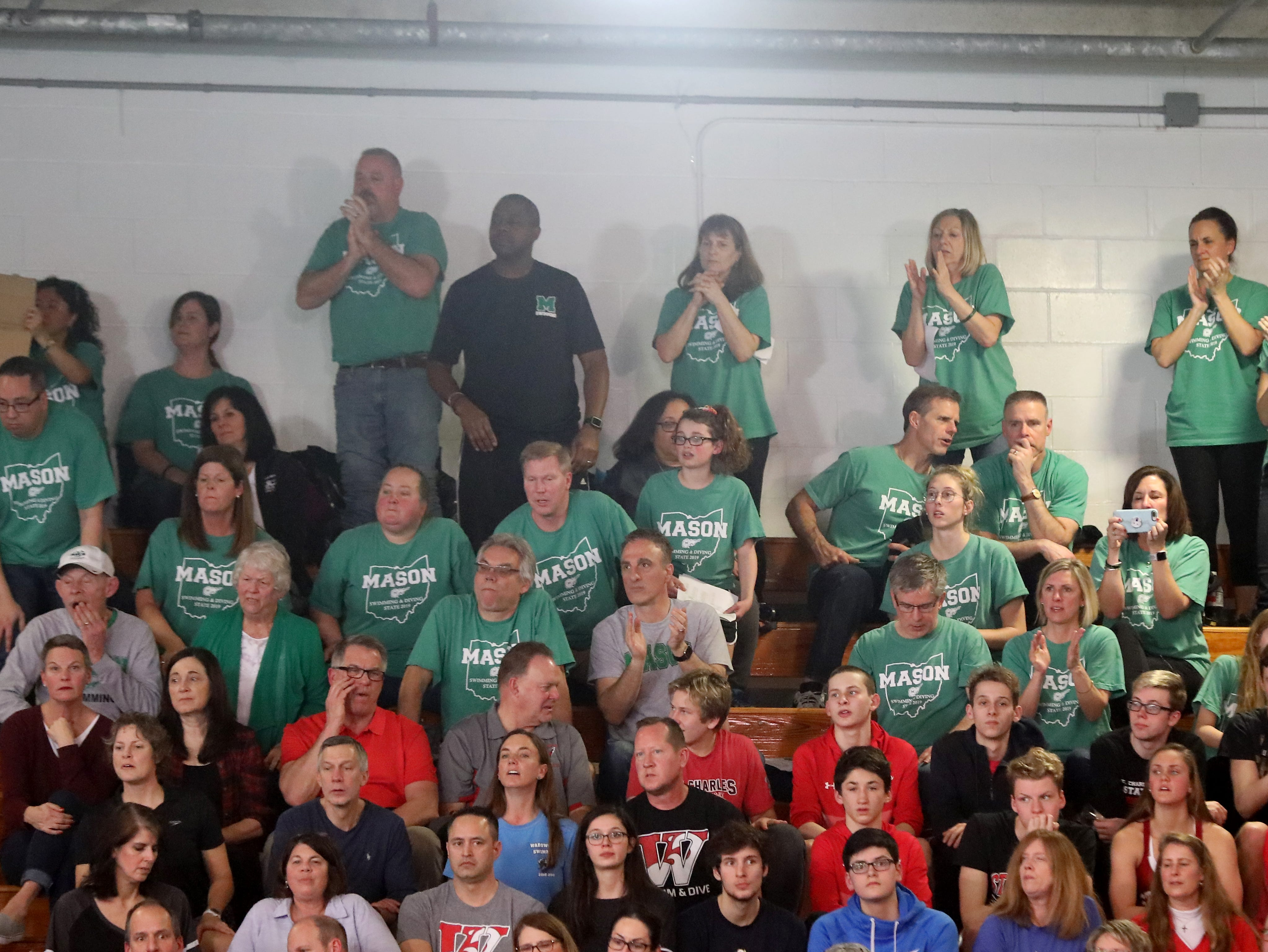 Mason fans cheer on the Comets at the OHSAA state swimming and diving championships in Canton Ohio, Friday, Feb. 23, 2019.