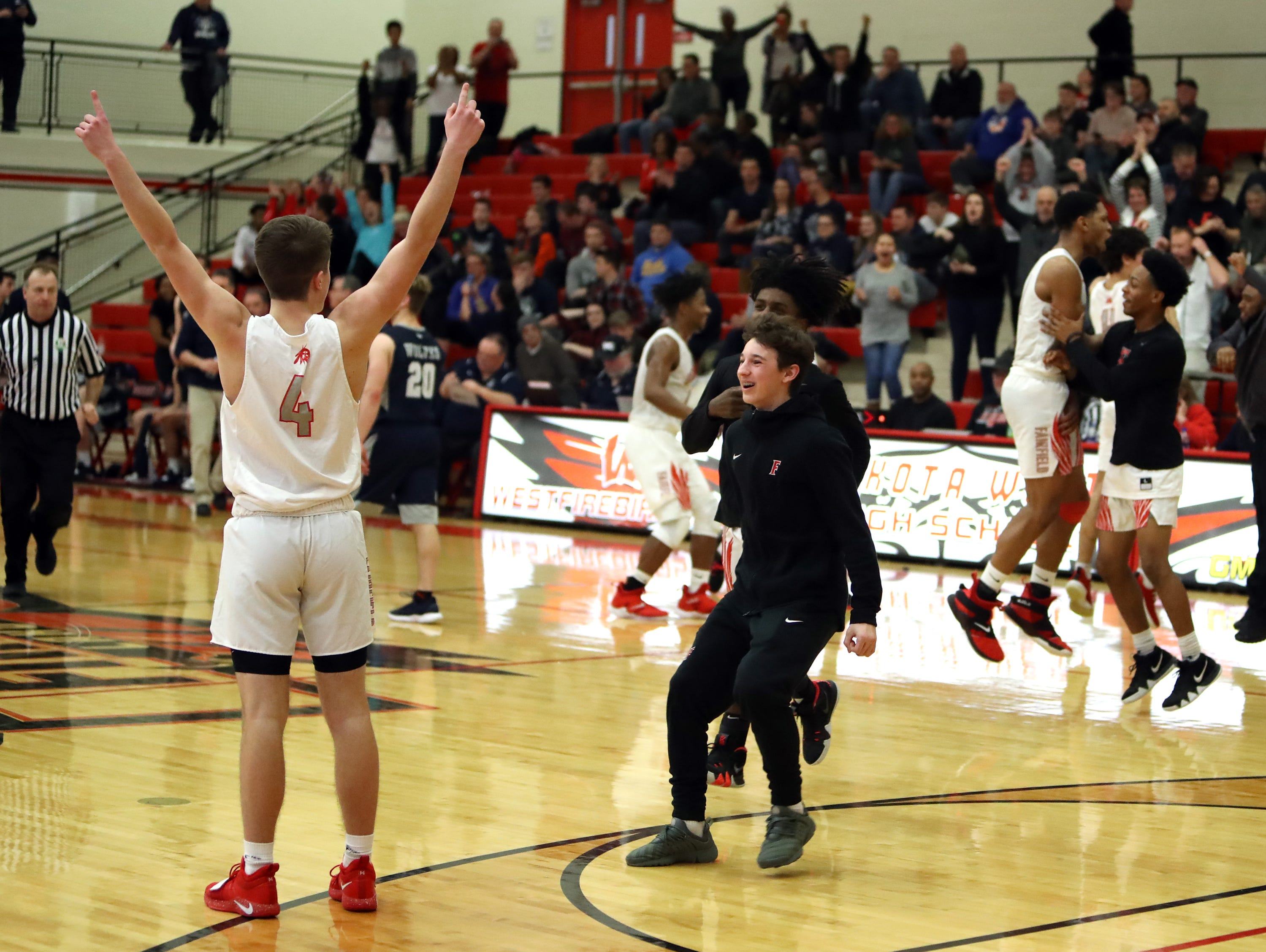 Fairfield guard Colin Singer raises his hands in triumph after knocking down his free throws to give the Indians the final lead. Fairfield defeated West Clermont 49-46.