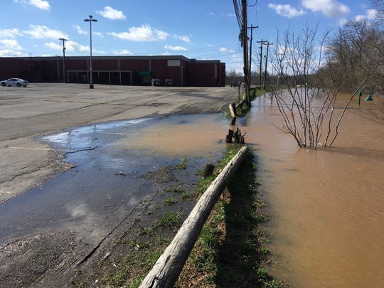The Cumberland River had inundated the Riverwalk, at right, and spilled into the low back side of the Two Rivers Mall parking lot at 10 a.m. on Sunday, Feb. 24, 2019.