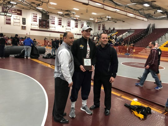 Voorhees' Lewis Fernandes poses with coach Eric Hall (right) and Region IV chairman John Ranieri after winning his second region title on Saturday, Feb. 23, 2019.