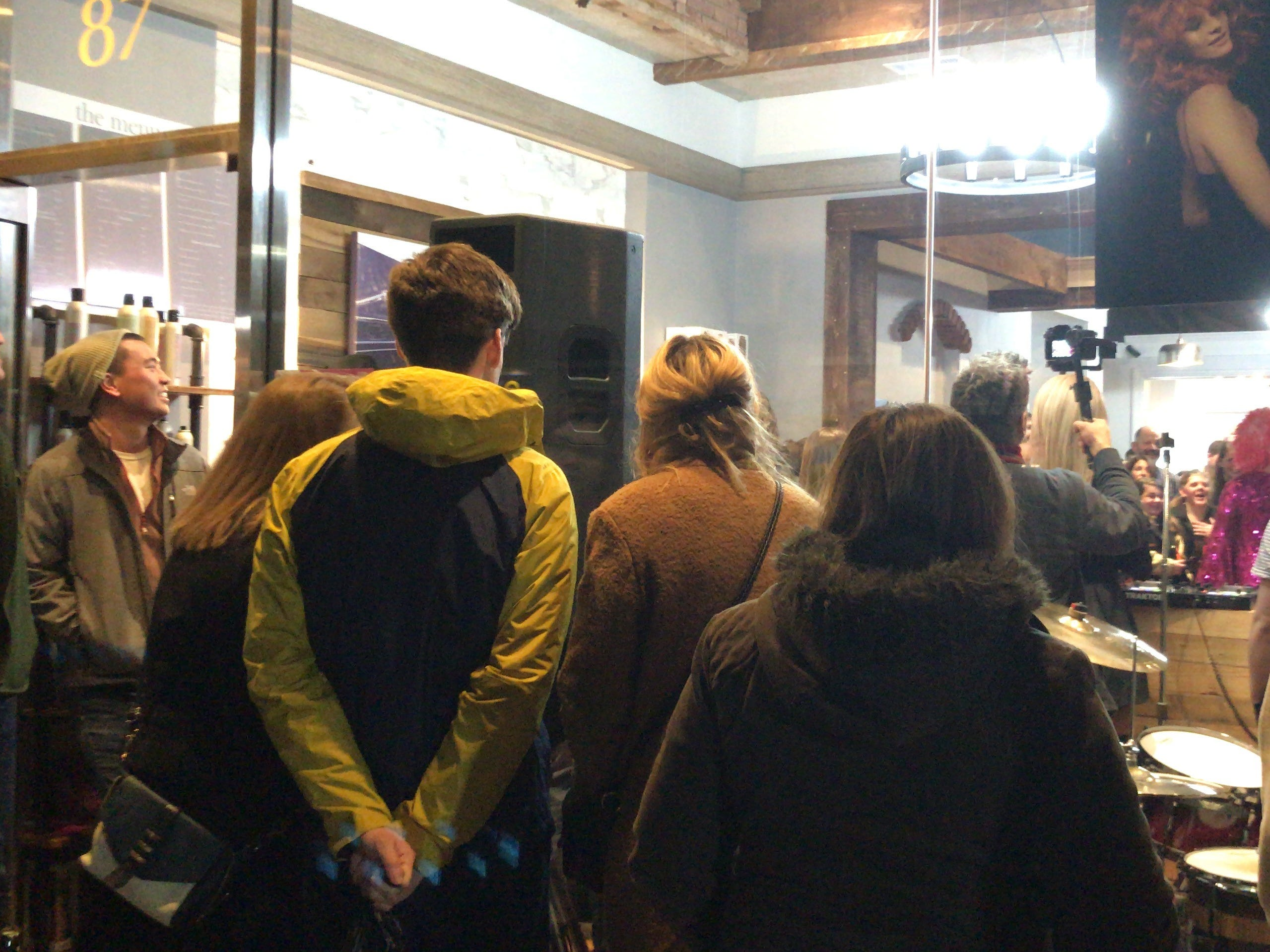 Onlookers at the Feb. 22 grand re-opening celebration of Illustrated Beauty in Somerville.