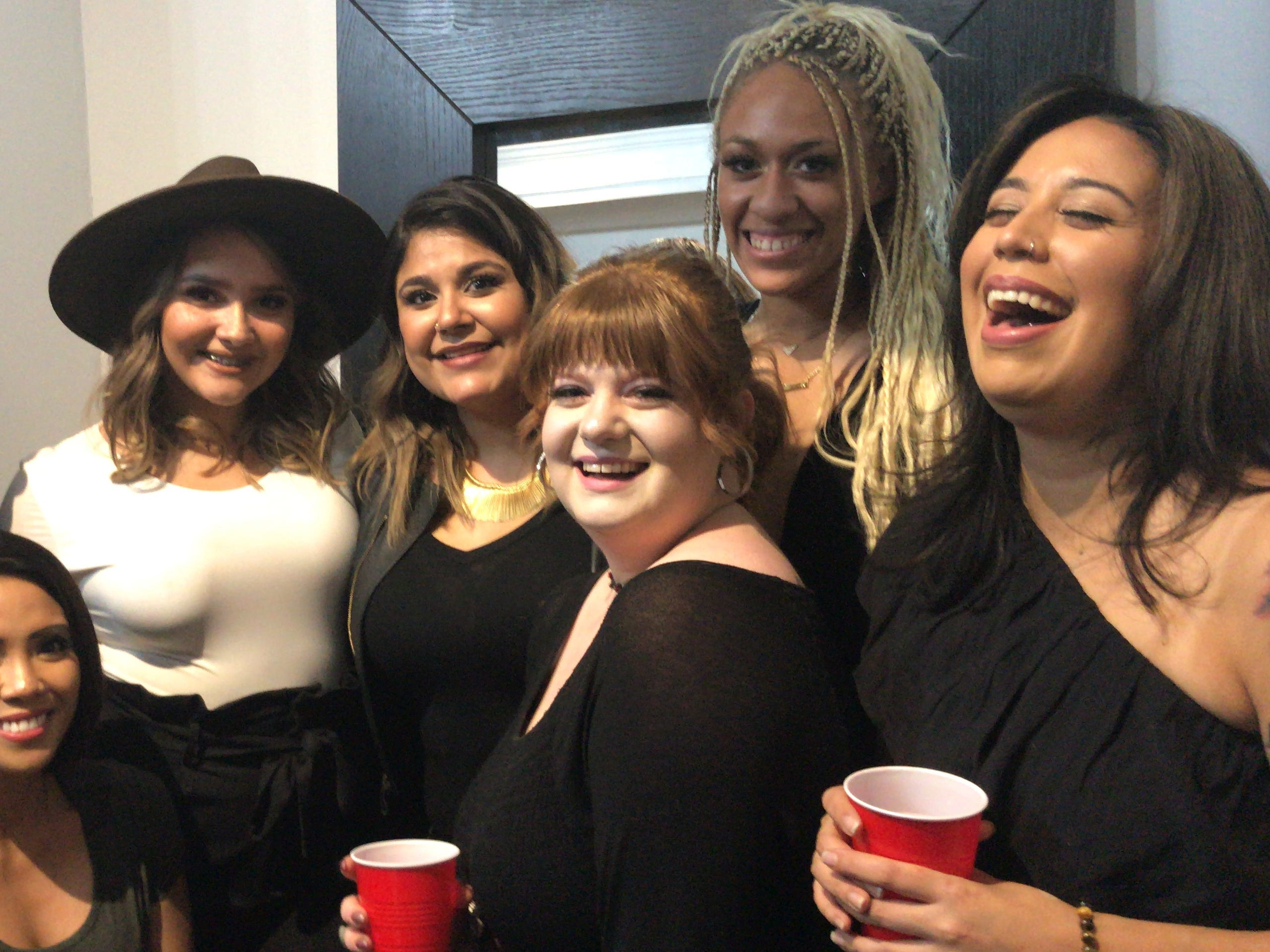 Jenny Jacome, center, is pictured with her staff at Illustrated Beauty in Somerville. From left to right are Amanda Fleming, Cielona Bocco, Hayley Terrell, Ashley Neuman, Zhane Sweeney, and Amanda Hidalgo.