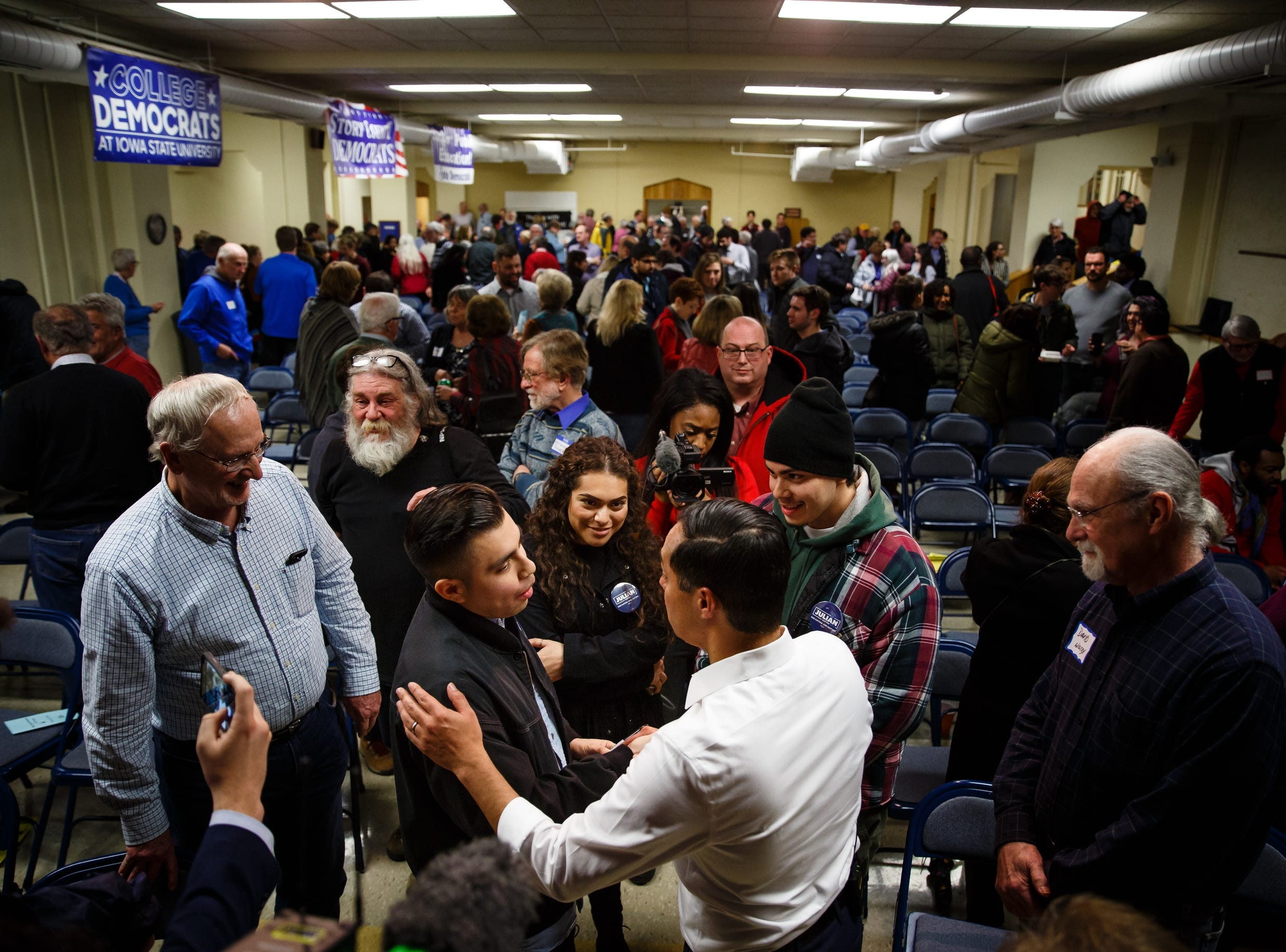 Former Housing and Urban Development Secretary Julian Castro greats people after his speech at the Story County Democrats: Annual Soup Supper Fundraiser on Saturday, Feb. 23, 2019 in Ames.