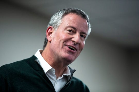 New York City Mayor Bill de Blasio, who is considering a run for president, addresses a gathering of people during a meet and greet event hosted by the Asian & Latino Coalition on Sunday, Feb. 24, 2019, in Des Moines.