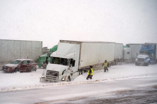 First responders check on drivers following a multi-vehicle crash on westbound Interstate 80 between Lincoln and Omaha, Nebraska, Saturday.