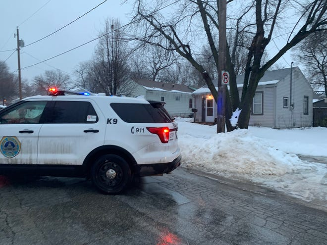 A Des Moines police car is parked Saturday outside of a home near where a shooting took place in the 3200 block of State Avenue.