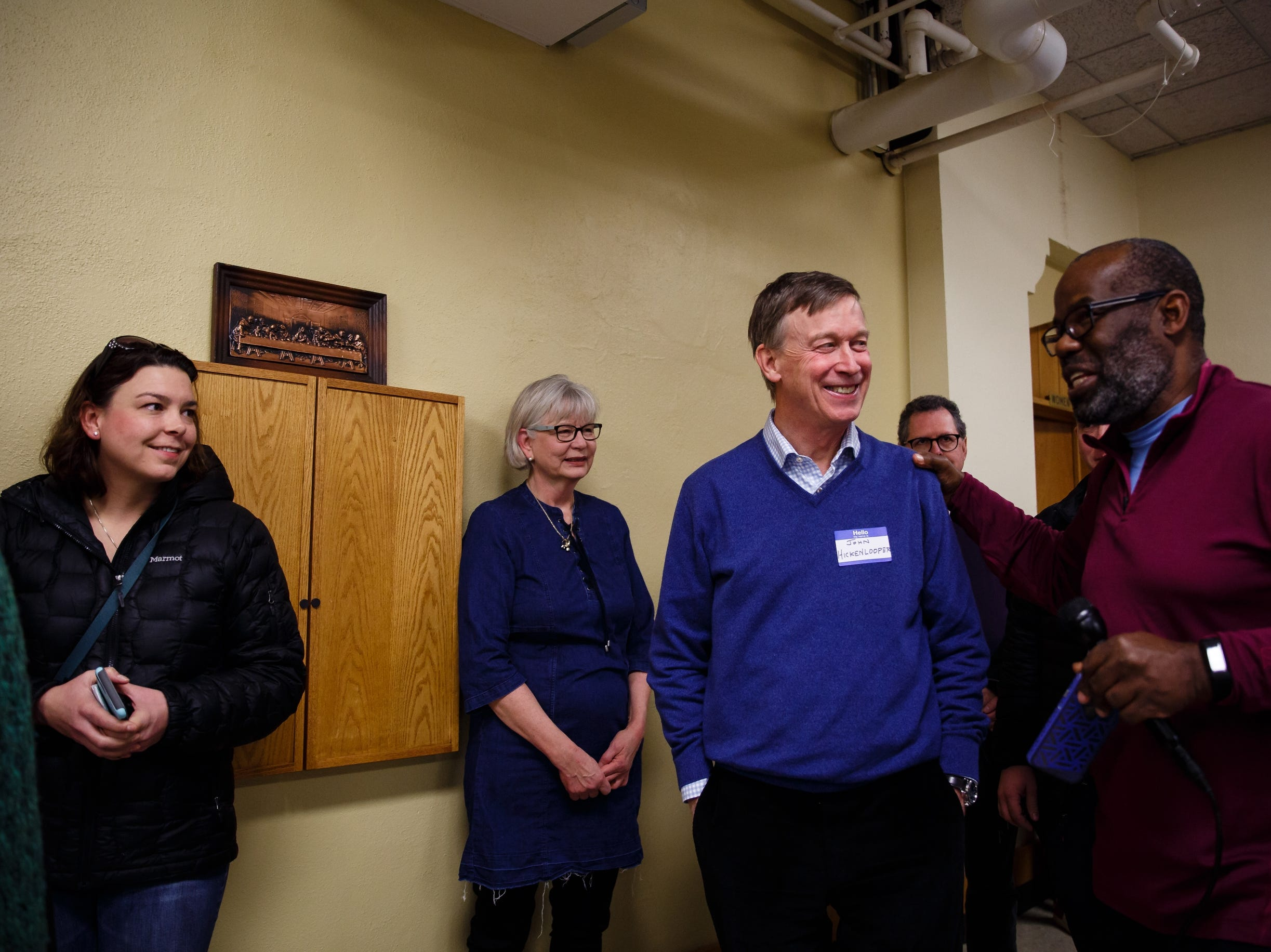 Former Governor of Colorado John Hickenlooper talks to people before speaking at the Story County Democrats: Annual Soup Supper Fundraiser on Saturday, Feb. 23, 2019 in Ames.