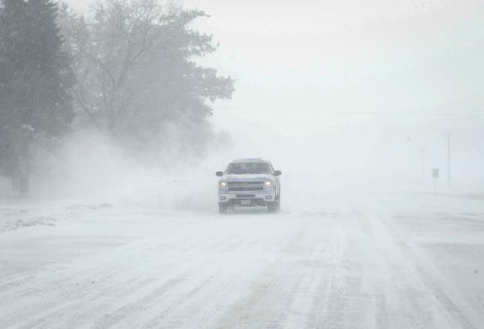 A truck braves whiteout conditions in rural Howard County on Sunday, Feb. 24, 2019, after an overnight winter storm dumped several inches of snow across much of Iowa.