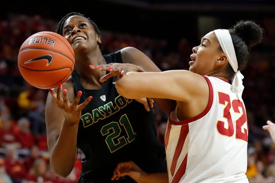 Baylor center Kalani Brown (21) is fouled by Iowa State forward Meredith Burkhall (32) while driving to the basket during the first half of an NCAA college basketball game, Saturday, Feb. 23, 2019, in Ames, Iowa.