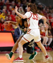 Baylor guard Chloe Jackson, left, drives past Iowa State guard Alexa Middleton (33) during the second half of an NCAA college basketball game, Saturday, Feb. 23, 2019, in Ames, Iowa. Baylor won 73-60.