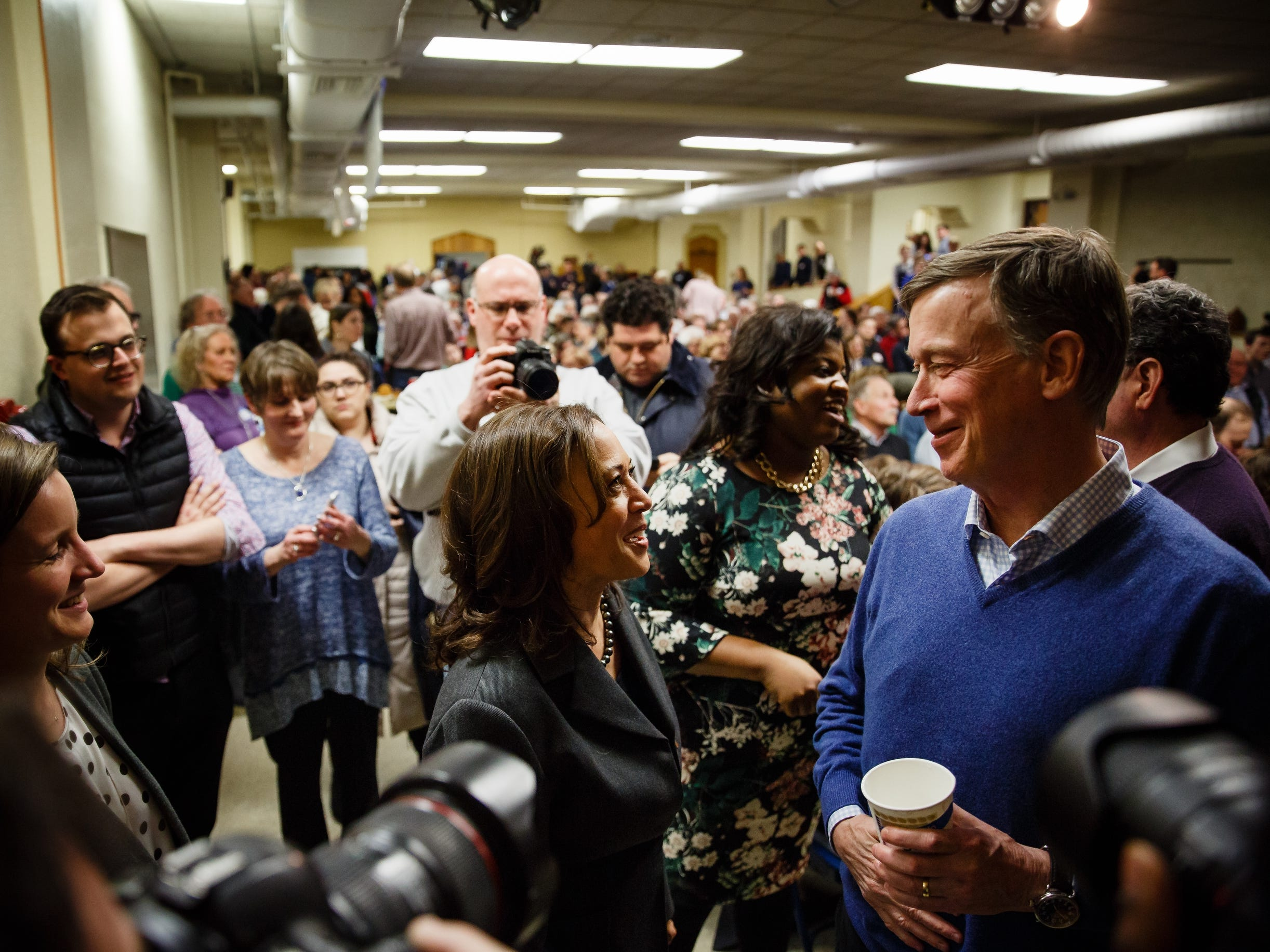 California Sen. Kamala Harris and former Governor of Colorado John Hickenlooper talk before they both speak at the Story County Democrats: Annual Soup Supper Fundraiser on Saturday, Feb. 23, 2019 in Ames.