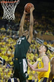 Michigan State forward Xavier Tillman scores against Michigan center Jon Teske during first half action Sunday, February 24, 2019 at the Crisler Center in Ann Arbor, Mich.