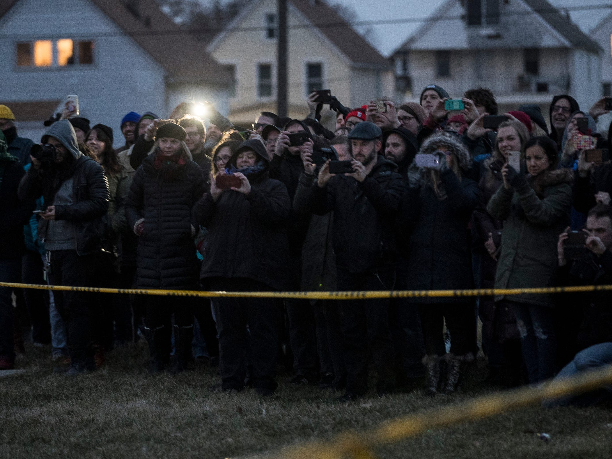 Spectators get ready to watch stuntman Schuyler White attempts to break the World Record of most consecutive jumping jacks with full-body burn at the Veterans Park in Hamtramck, Saturday, Feb. 23, 2019. White finishes with 12 jumps.
