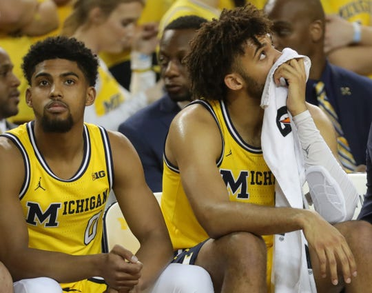Isaiah Livers, right, and David Dejulius on the bench during Michigan's 77-70 loss.
