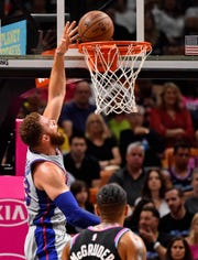 Detroit Pistons forward Blake Griffin (23) shoots the ball against the Miami Heat during the first half at American Airlines Arena on Feb. 23, 2019.