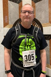 Doug Wright, 60, of Battle Creek, who has pulmonary fibrosis took on 42 flights of stairs at the Ally Detroit Center to support the American Lung Association's Fight for Air on Sunday, Feb. 24.