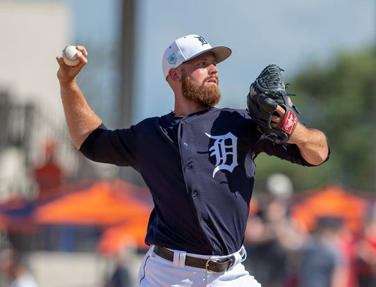 Tigers pitcher Buck Farmer throws a pitch during the fifth inning of the Tigers' 10-6 exhibition loss to the Phillies on Sunday, Feb. 24, 2019, in Lakeland, Florida.