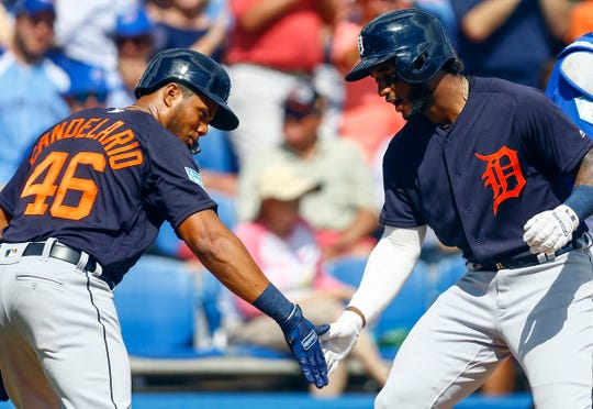 Detroit Tigers second baseman Niko Goodrum (28) celebrates with Detroit Tigers third baseman Jeimer Candelario (46) after hitting a two run homer in the third inning of a spring training baseball game against the Toronto Blue Jays at Dunedin Stadium on Feb. 23, 2019.