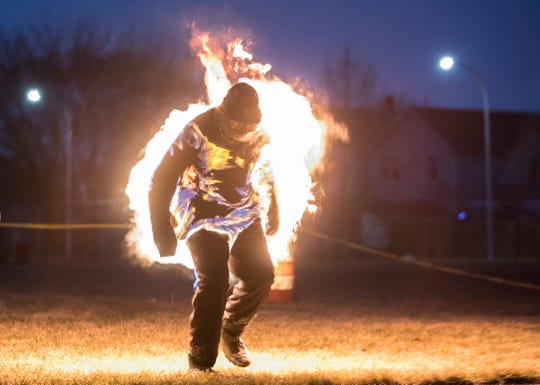 Stuntman Schuyler White attempts to break the World Record of most consecutive jumping jacks with full-body burn at the Veterans Park in Hamtramck, Saturday, Feb. 23, 2019. He finished with 12 jumps.