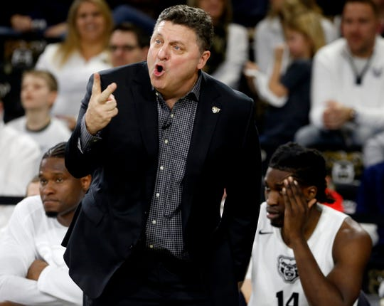 Oakland University coach Greg Kampe yells instructions to his players during the 95-75 win against Detroit Mercy at the O'rena in Rochester, Saturday, Feb. 23, 2019.