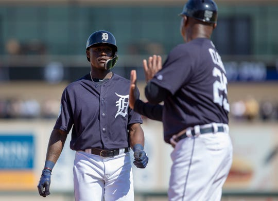 Tigers third base coach Dave Clark, right, talks to Daz Cameron during a 2019 spring training game.