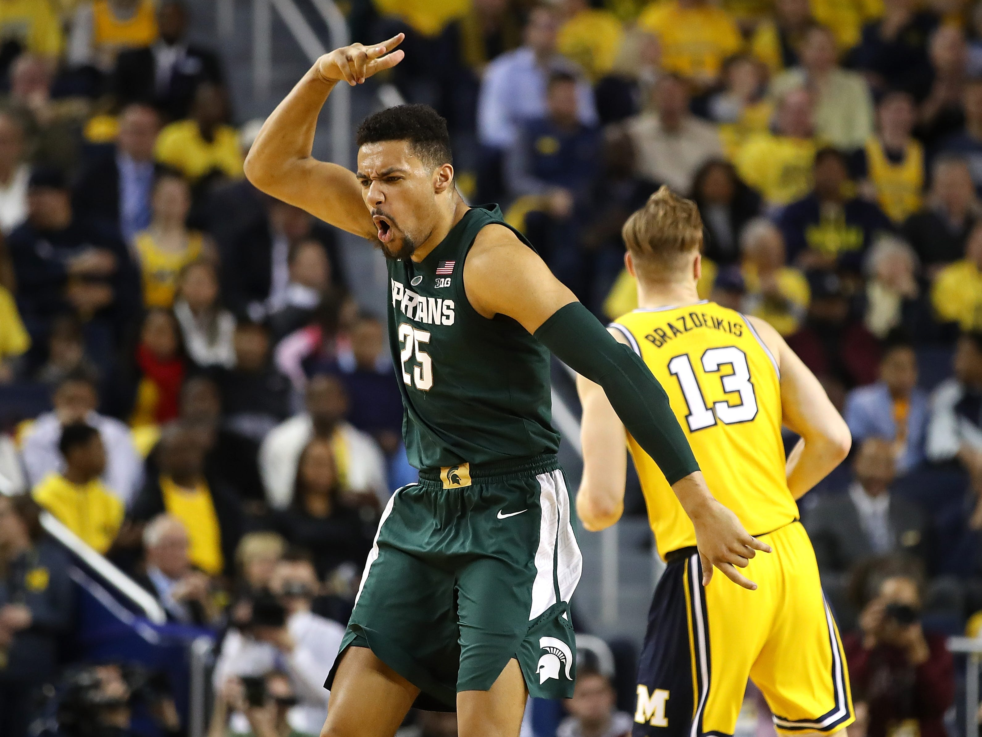 Michigan State's Kenny Goins reacts after a 3-point basket against Michigan at Crisler Center on Feb. 24, 2019 in Ann Arbor.