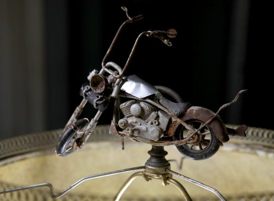 The screw on cap for the lamp shade that Matthew Urquhart of Royal Oak made out of thrown out parts into a motorcycle. Urquhart is all for people reclaiming throwing away items and doesn't understand why some cities like Royal Oak have laws on the books against such a thing.