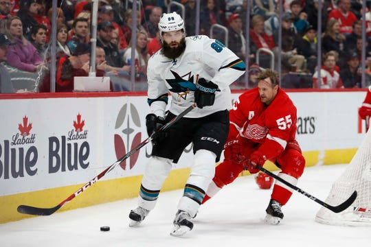 Sharks defenseman Brent Burns skates past Red Wings defenseman Niklas Kronwall during the first period on Sunday, Feb. 24, 2019, at Little Caesars Arena.