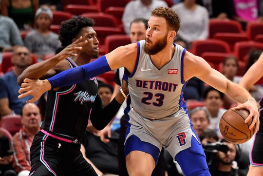 Detroit Pistons forward Blake Griffin (23) drives the ball around Miami Heat guard Josh Richardson (0) during the first half at American Airlines Arena on Feb. 23, 2019.