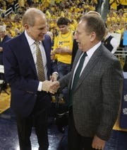 Michigan coach John Beilein, left, and Michigan State coach Tom Izzo chat before the game Sunday, Feb. 24, 2019 at the Crisler Center in Ann Arbor.