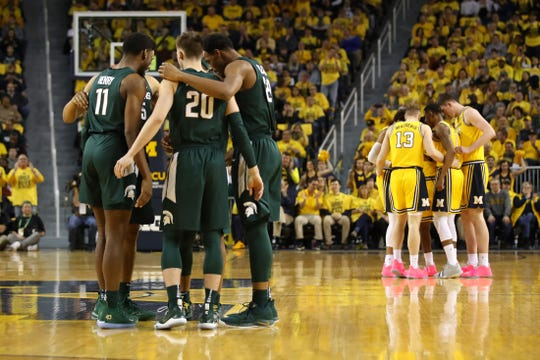 The Michigan State Spartans prepare to play the Michigan Wolverines at Crisler Center on Feb. 24, 2019 in Ann Arbor.
