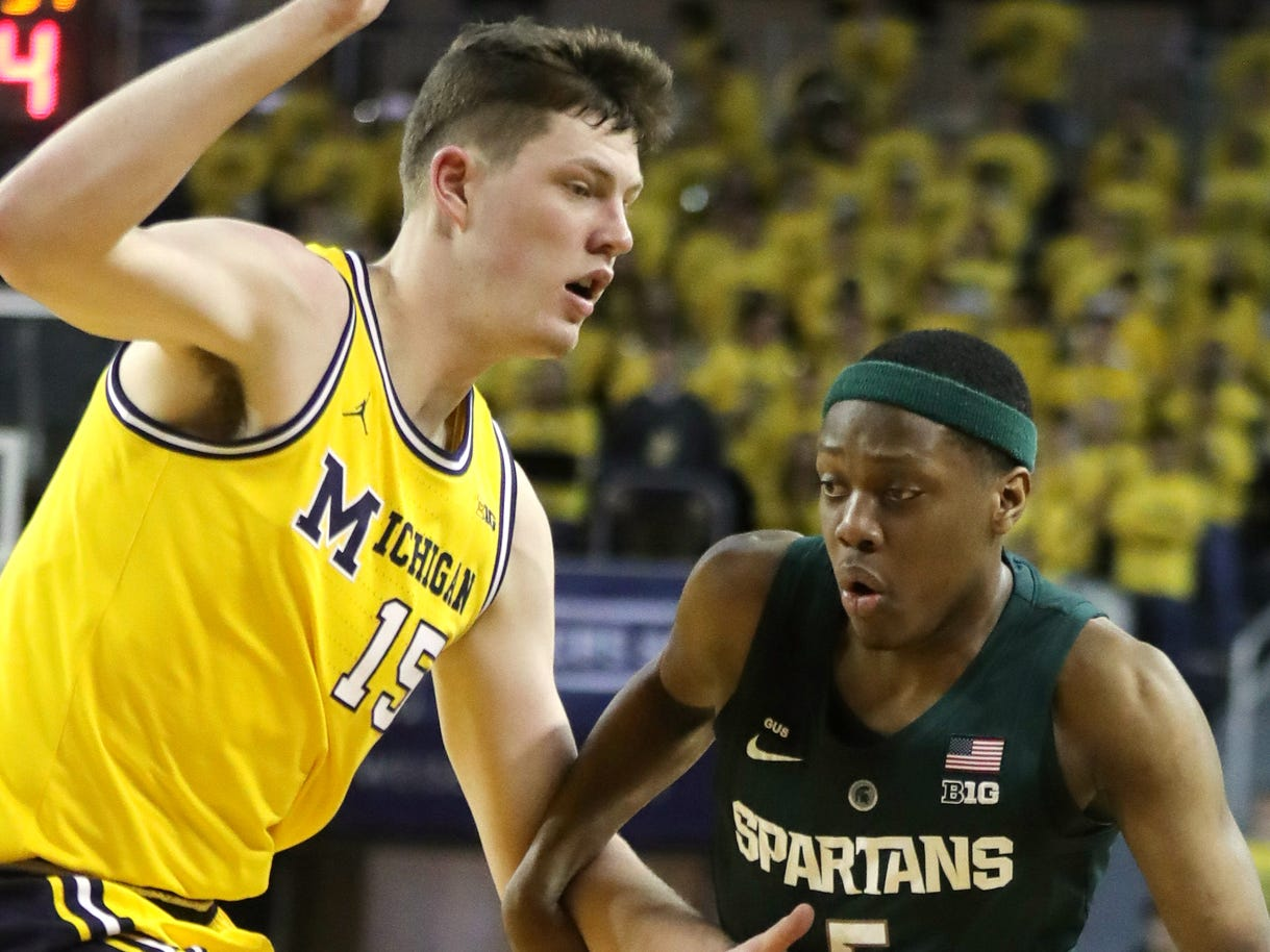 Michigan State guard Cassius Winston drives against Michigan center Jon Teske during the first half on Sunday, February 24, 2019 at the Crisler Center in Ann Arbor.