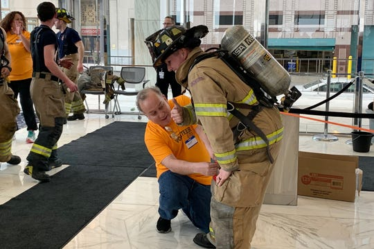 Tanya Heinig, a firefighter for the West Bloomfield Fire Department, offers up a thumbs up after climbing up to the 28th floor of the One Woodward building and back down on Sunday, Feb. 24 to support the American Lung Association Fight for Air.