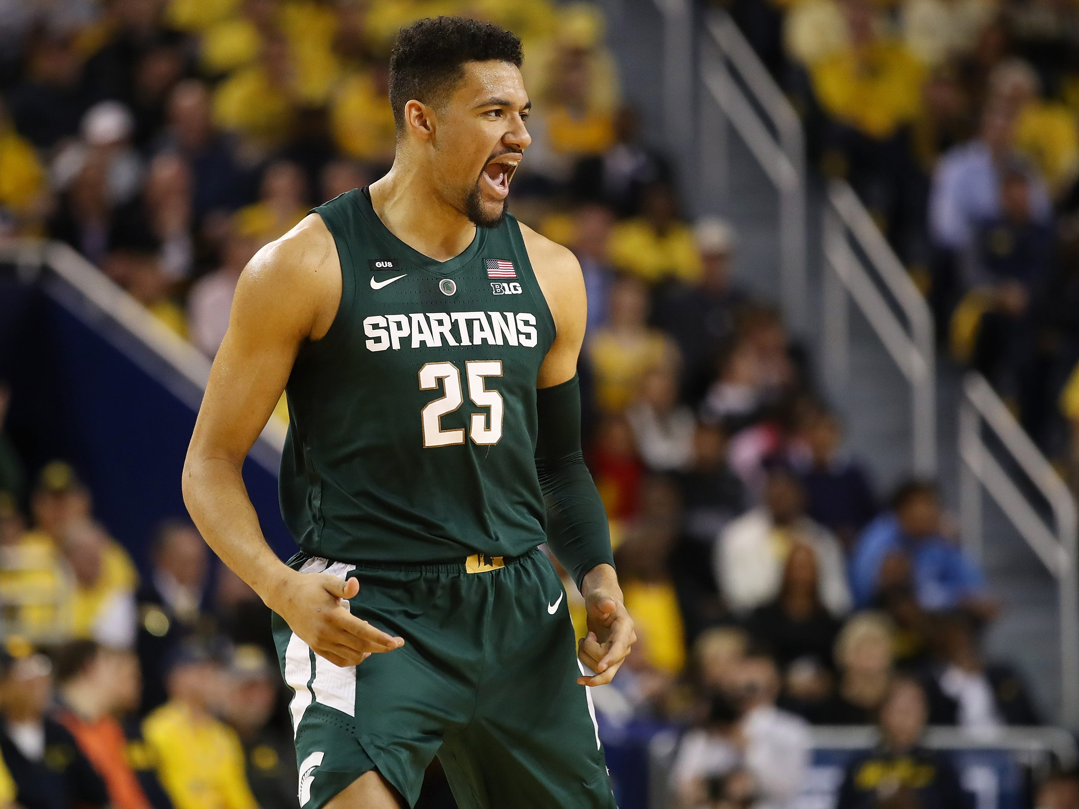Michigan State's Kenny Goins reacts after a 3-point basket in the first half against Michigan at Crisler Center, Feb. 24, 2019 in Ann Arbor.