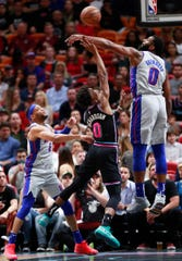 Miami Heat guard Josh Richardson, center, attempts to shoot against Detroit Pistons center Andre Drummond, right, and guard Bruce Brown (6) during the first half of an NBA basketball game, Saturday, Feb. 23, 2019, in Miami.