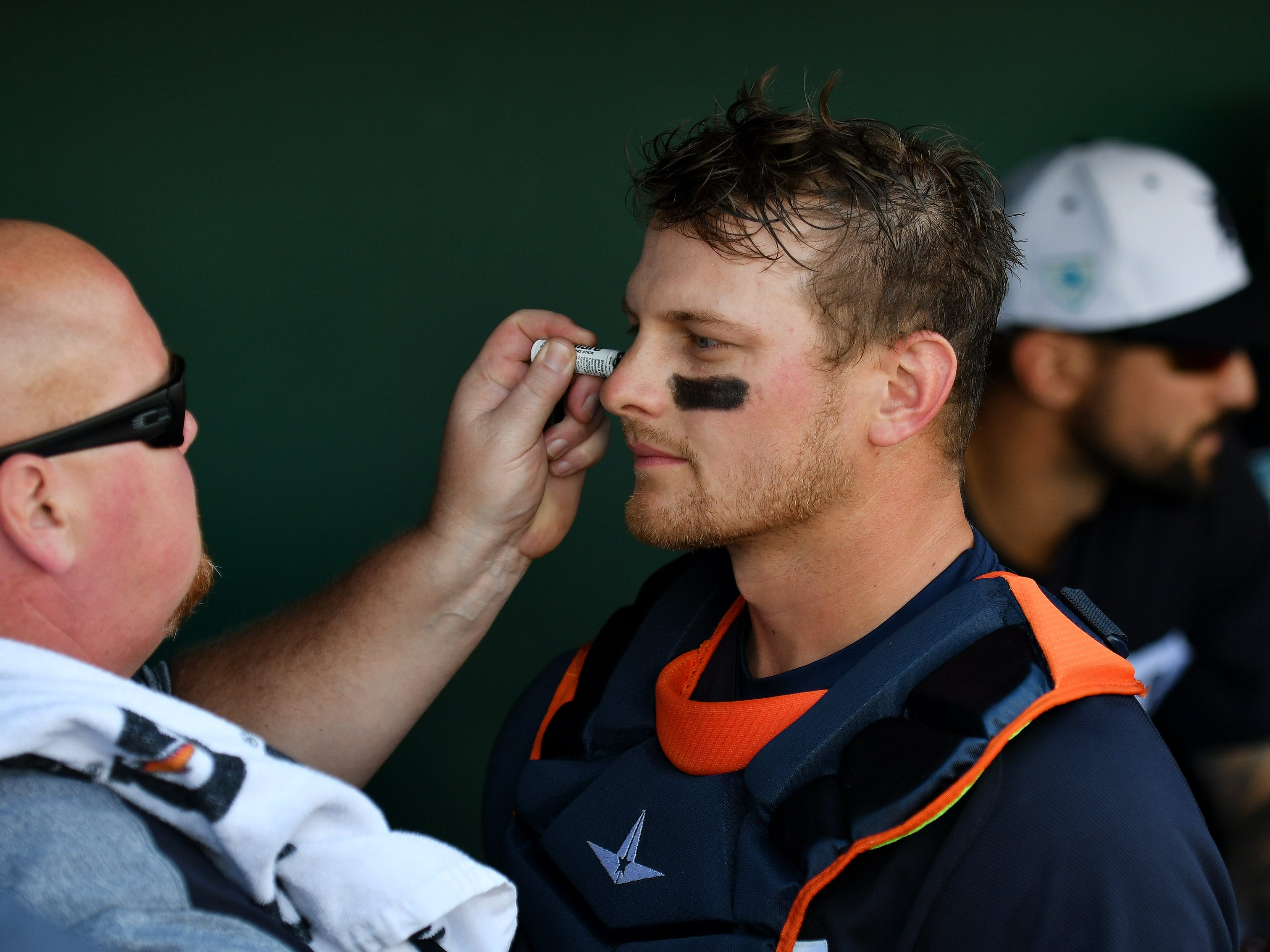 Tigers head athletic trainer Doug Teter puts eye black on catcher John Hicks at the start of the game. Detroit Tigers lose 10-6 to the Philadelphia Phillies at Publix Field at Joker Marchant Stadium in Lakeland, Fla. on Feb. 24, 2019.