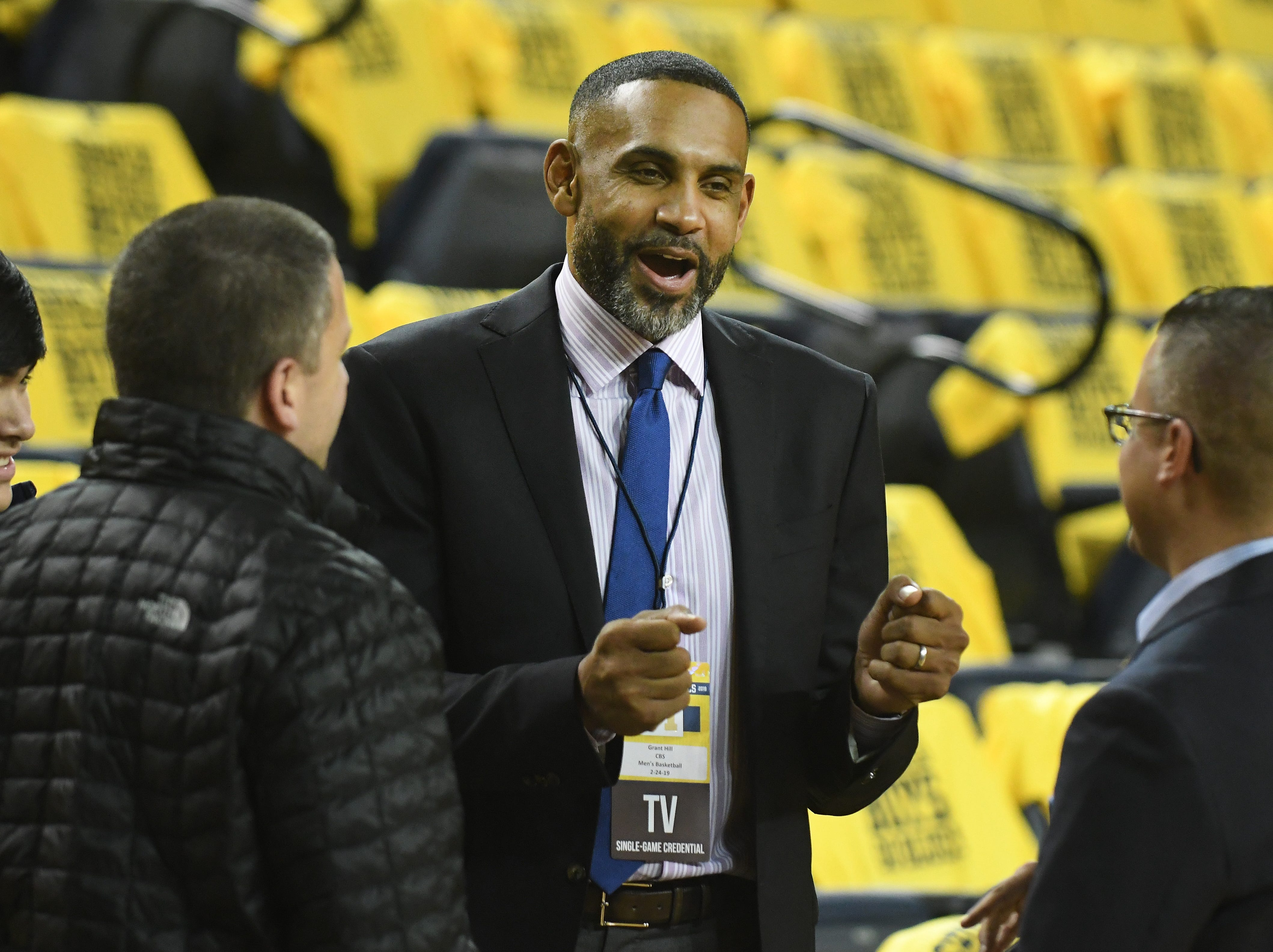 Grant Hill of CBS chats on the court before University of Michigan takes on Michigan State at Crisler Center.