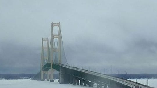 Winds are blowing across the bridge surface in excess of 50 miles per hour, according to the Mackinac Bridge Authority website.