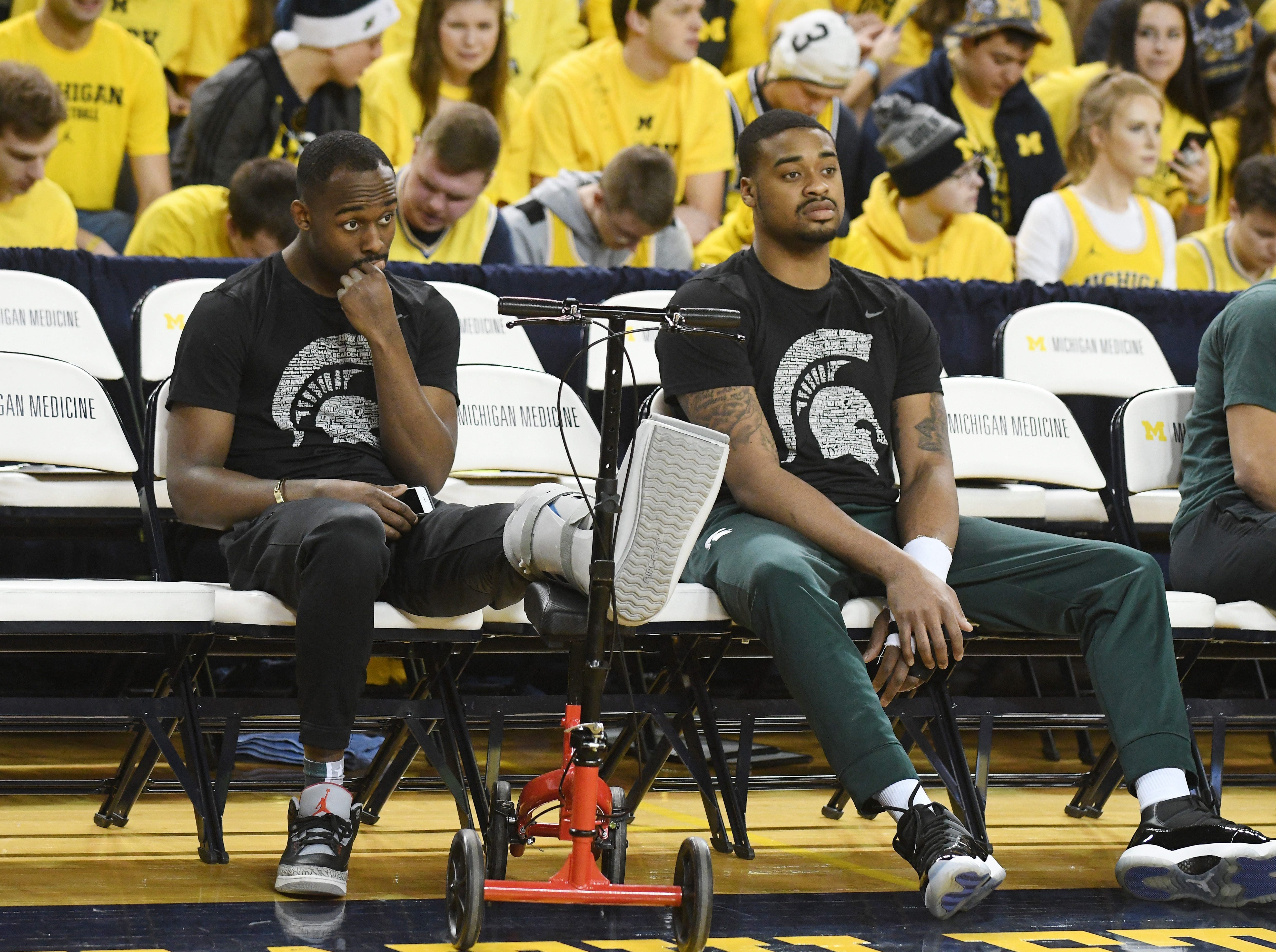 Injured Michigan State players Joshua Langford and Nick Ward on the bench during warmups before MSU takes on Michigan at Crisler Center in Ann Arbor, Michigan on February 24, 2019.