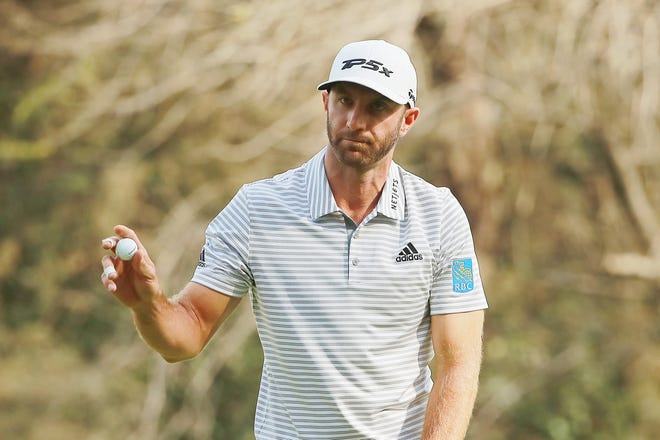 Dustin Johnson acknowledges the crowd on the 14th green during the third round Saturday of World Golf Championships-Mexico Championship at Club de Golf Chapultepec.