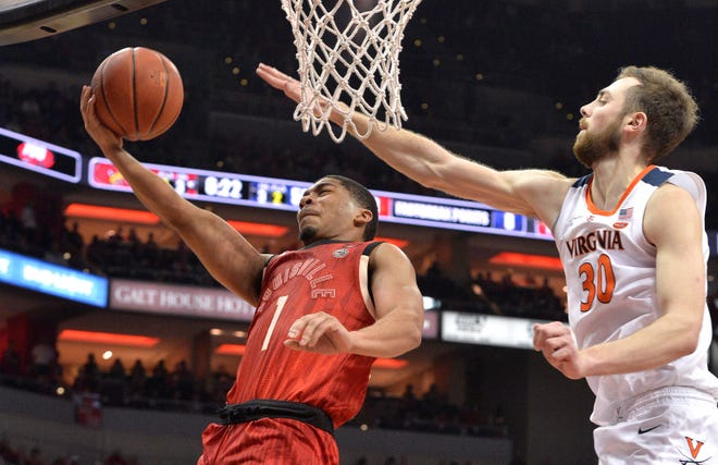 Louisville guard Christen Cunningham (1) tempts a layup past the defense of Virginia forward Jay Huff (30) during the second half Saturday. Virginia won 64-52.