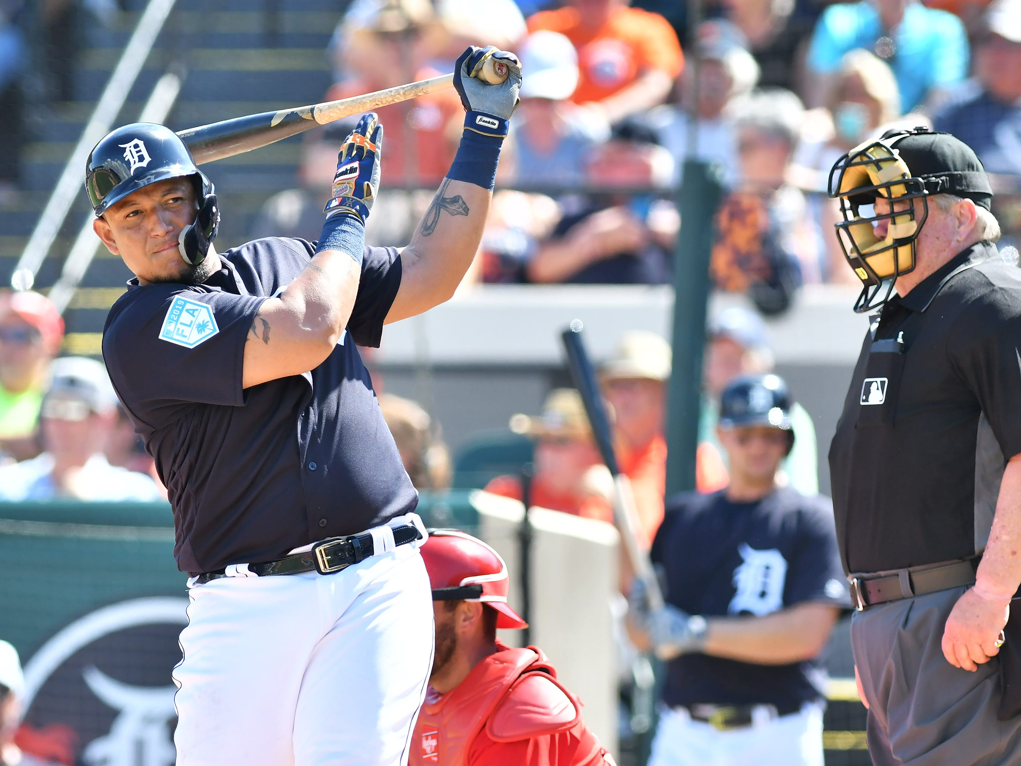 Tigers' Miguel Cabrera loosens up before his at bat in the second inning.